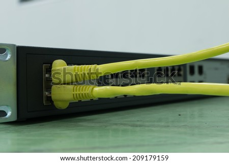 Lan cable connected to L2 switch  - stock photo