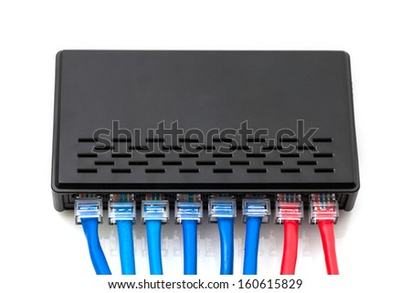 LAN network switch with ethernet cables plugged in - stock photo