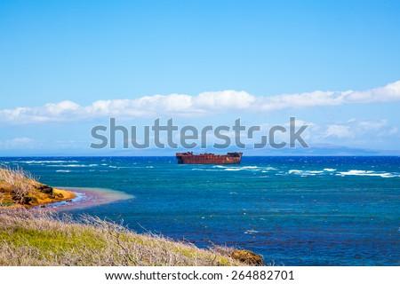 Lanai, Hawaii.  Shipwreck beach.  Liberty Ship or YOGN 42 concrete barge.  - stock photo