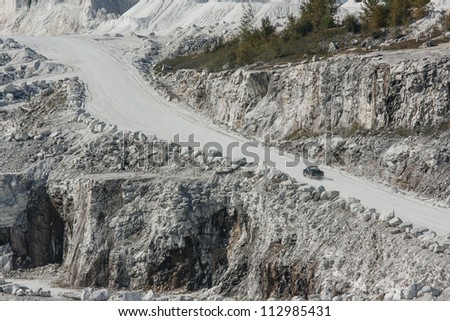 LANARK COUNTY, CANADA - SEPTEMBER 2: A pickup truck drives through Tatlock Quarry on September 2, 2012 in Lanark County, Ontario. This open pit mine is the largest calcium-carbonate quarry in Canada.