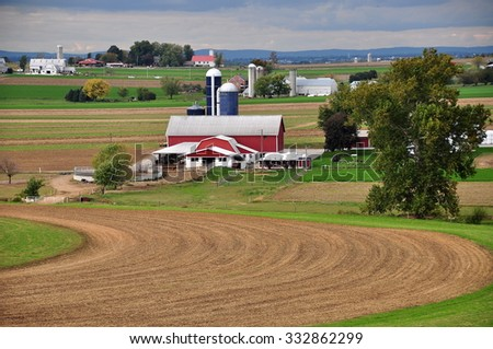 Lancaster County, Pennsylvania - October 14, 2015:  Freshly plowed fields and an Amish farm with barns and silos