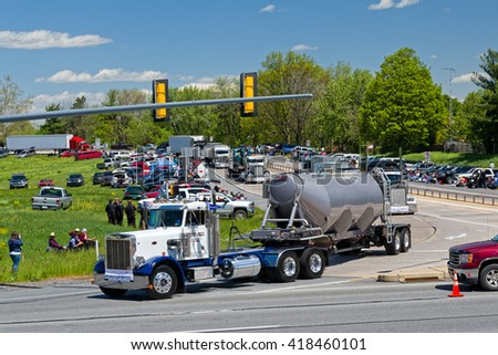 LANCASTER, PA - MAY 8, 2016: Make-A-Wish Foundation sets a new Guinness World Record for the largest truck convoy.  Truckers grant a Lancaster County ride to children with life-threatening illnesses.