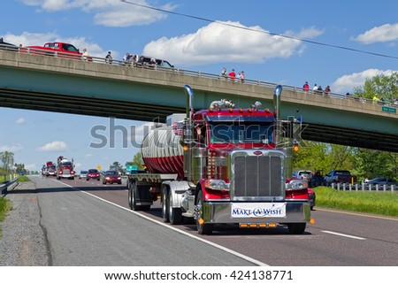 LANCASTER PA - MAY 8 2016: Make-A-Wish Foundation sets a new Guinness World Record for the largest truck convoy. On Mother's Day truckers grant a ride to children with life-threatening illnesses.