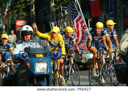 Lance Armstrong and US Postal Team on Champs Elysees in Paris 2004 - stock photo