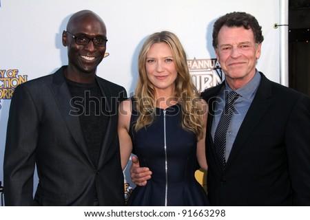 Lance Reddick, Anna Torv, John Noble at the 37th Annual Saturn Awards, Castaway, Burbank, CA. 06-23-11 - stock photo