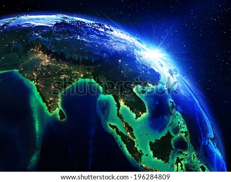 land area in India, China and Indonesia the night - maps elements of this image furnished by NASA  - stock photo