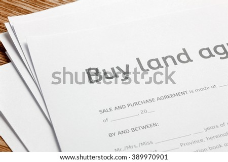 land contract form on wood background. - stock photo