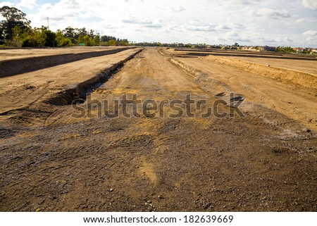Land is prepped and ready for foundations to be layed at this housing development under construction. - stock photo