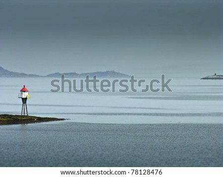 Land marker buoy in norway sea in a foggy day - stock photo