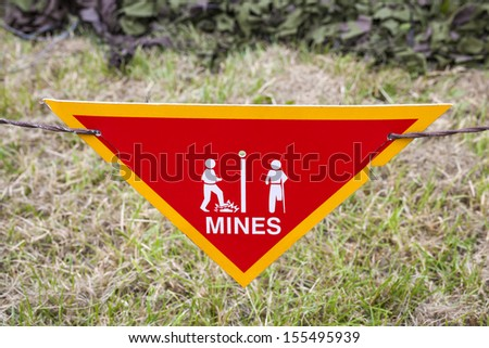 Land mine or minefield danger warning sign in a war zone area - stock photo