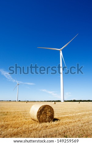 Land scape with wind turbines and agriculture. Clean and renewable energy. - stock photo