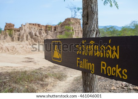 Land Texture with warning signage of falling rocks at Na Noi earth pillar in Nan, Thailand