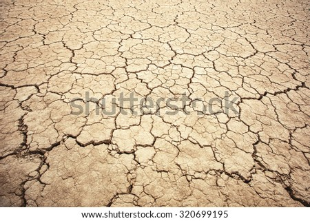 Land with dry and cracked ground texture. Desert, hot climate, dry salt earth - stock photo