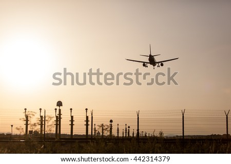 Landing Airplane at Sunset.