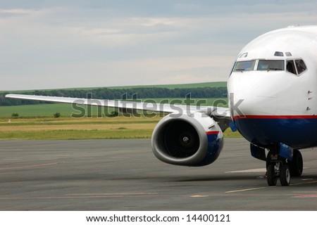 landing airplane in airport - stock photo