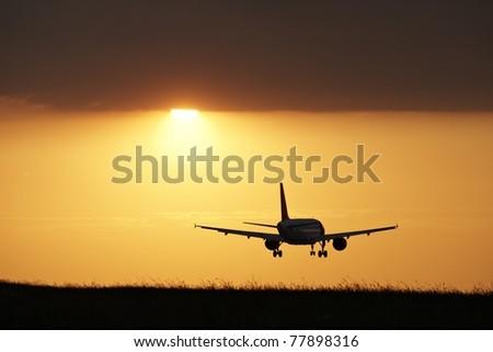 Landing at sunset, Prague Ruzyne Airport - stock photo