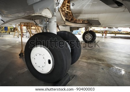 Landing gear of airplane under maintenance. - stock photo