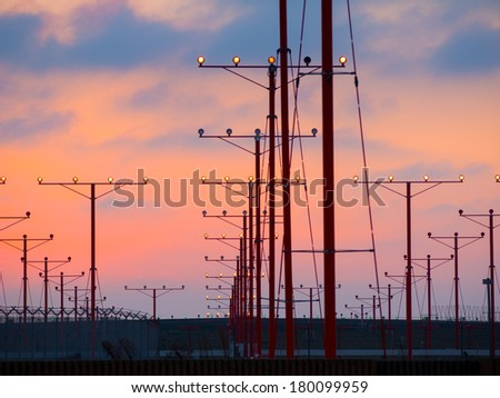 Landing lights at sunset in Los Angeles International Airport LAX - stock photo