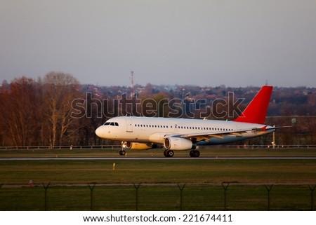 Landing of a passenger plane - stock photo
