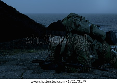 Landing operation. Troopers. Actions of Russian Special Forces behind enemy lines at night. - stock photo