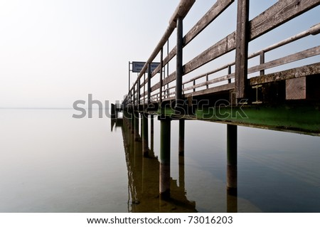 Landing pier on the Lake Chiemsee in Bavaria in Germany - stock photo