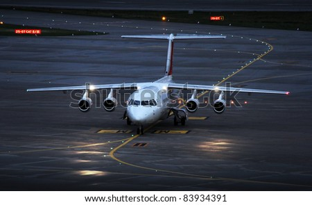 landing plane on the airport in the afternoon - stock photo
