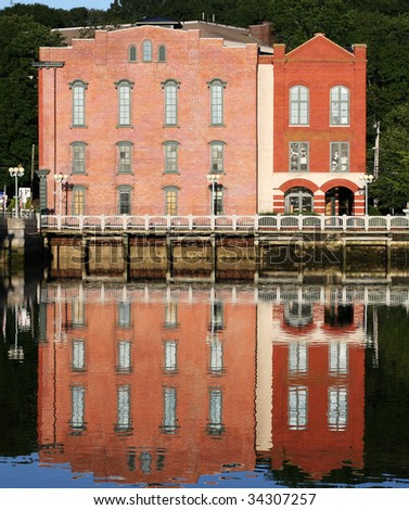 landmark buildings in westport, CT with reflection in water - stock photo