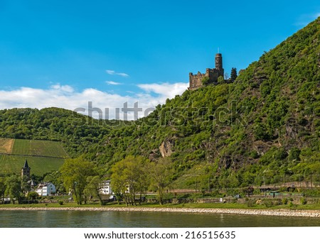 Landmark castle in the famous Rhine Gorge region north of Rudesheim, Germany - stock photo