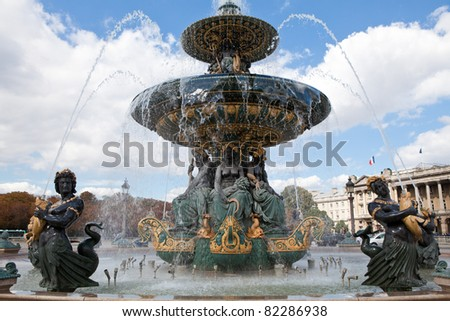 Landmark famous sculptural fountain of River Commerce and Navigation on the Place de la Concorde in Paris France on the cloudy sky background - stock photo