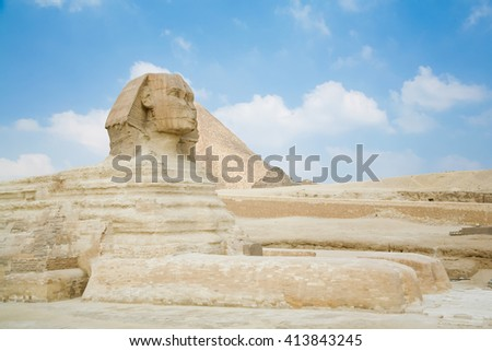 landmark of famous Great Sphinx, from century XXVI Before Christ, and behind the Great Pyramid of Khufu, in Giza next to Cairo city Egypt, Africa - stock photo