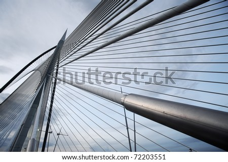 Landmark of modern silver steel bridge at dusk in Putrajaya, Malaysia. Asia - stock photo