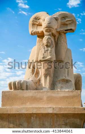 landmark of ram-headed Sphinx statue, symbol of god Amon, with pharaoh Ramses II sculpture, public monument next to Karnak Temple in Luxor city, Egypt, Africa - stock photo