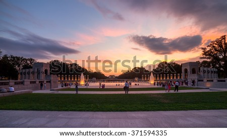 Landmark World War II Memorial fountains at the National Mall in Washington DC seen at sunset. - stock photo