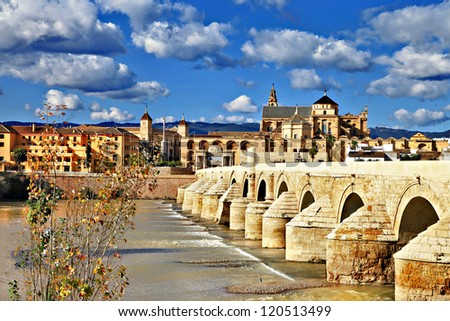 landmarks of Spain - Cordoba. Andalusia. view with mosque and bridge - stock photo