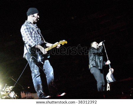 "LANDOVER, MD - SEPT 29, 2009: The Edge, guitarist of the Irish rock band U2, performs live with vocalist Bono and bassist Adam Clayton at FedEx Field during the band's ""360 Tour""."