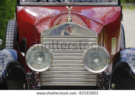 LANDSBERG, GERMANY - JULY 9: Oldtimer rally for at least 80 years old antique cars with Emily on Rolls Royce, built at year 1930, photo taken on July 9, 2011 in Landsberg, Germany - stock photo