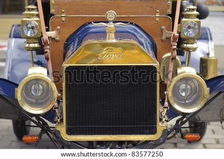 LANDSBERG, GERMANY - JULY 9: Oldtimer rally for at least 80 years old antique cars with Ford T, Runaboat, built at year 1911, photo taken on July 9, 2011 in Landsberg, Germany - stock photo