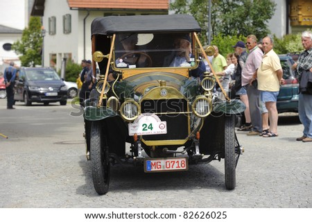 LANDSBERG, GERMANY - JULY 9: Oldtimer rally for at least 80 years old antique cars with Mercedes Benz, built at year 1912, photo taken on July 9, 2011 in Landsberg, Germany - stock photo