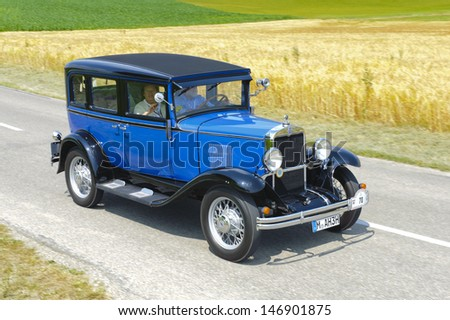 LANDSBERG, GERMANY - JULY 13: Oldtimer rallye for at least 80 years old antique cars with Chevrolet Sedan AD Universal, built at year 1930, photo taken on July 13, 2013 in Landsberg, Germany