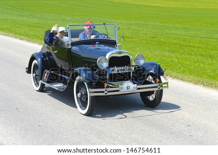 LANDSBERG, GERMANY - JULY 12: Oldtimer rallye for at least 80 years old antique cars with Ford A Cabriolet, built at year 1928, photo taken on July 12, 2013 in Landsberg, Germany