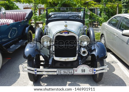 LANDSBERG, GERMANY - JULY 12: Oldtimer rallye for at least 80 years old antique cars with Ford A Phaeton, built at year 1929, photo taken on July 12, 2013 in Landsberg, Germany - stock photo