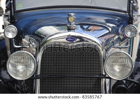 LANDSBERG, GERMANY - JULY 9: Oldtimer rallye for at least 80 years old antique cars with Ford, Typ A de luxe, Roadster, built at year 1927, photo taken on July 9, 2011 in Landsberg, Germany - stock photo