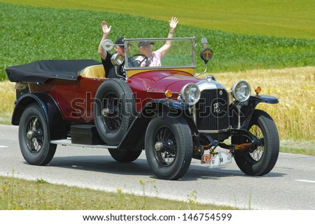 LANDSBERG, GERMANY - JULY 13: Oldtimer rallye for at least 80 years old antique cars with Rochet Schneider Tourer, built at year 1918, photo taken on July 13, 2013 in Landsberg, Germany