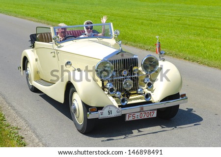 LANDSBERG, GERMANY - JULY 12: Oldtimer rallye for at least 80 years old antique cars with Rolls Royce 20 HP Cabriolet, built at year 1927, photo taken on July 12, 2013 in Landsberg, Germany - stock photo