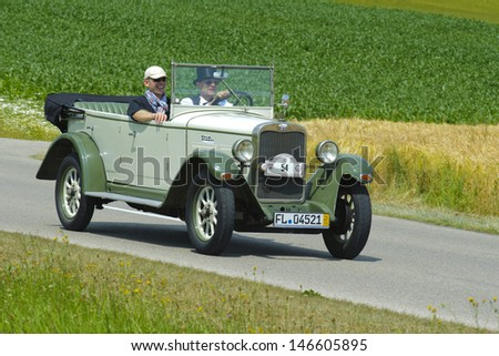 LANDSBERG, GERMANY - JULY 13: Oldtimer rallye for at least 80 years old antique cars with Wanderer W 10/1 Tourer, built at year 1928, photo taken on July 13, 2013 in Landsberg, Germany