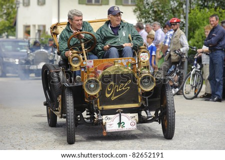 LANDSBERG, GERMANY - JULY 9:  Participants of the Oldtimer rallye for at least 80 years old antique cars with Opel, built at year 1909, photo taken on July 9, 2011 in Landsberg, Germany