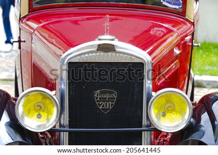 LANDSBERG, GERMANY - JULY 12, 2014: Public oldtimer rally in Bavarian city Landsberg for at least 80 years old veteran cars with a front view of Peugeot 201, built at year 1929 - stock photo