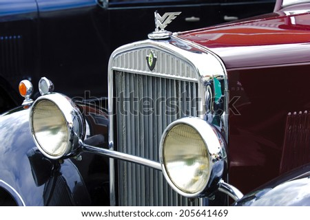 LANDSBERG, GERMANY - JULY 12, 2014: Public oldtimer rally in Bavarian city Landsberg for at least 80 years old veteran cars with a front view of Wanderer W10, built at year 1930 - stock photo