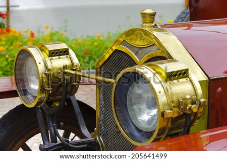 LANDSBERG, GERMANY - JULY 12, 2014: Public oldtimer rally in Bavarian city Landsberg for at least 80 years old veteran cars with a front view of Protos F32, built at year 1909 - stock photo