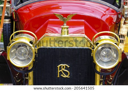 LANDSBERG, GERMANY - JULY 12, 2014: Public oldtimer rally in Bavarian city Landsberg for at least 80 years old veteran cars with a front view of Rochet-Schneider, built at year 1912 - stock photo